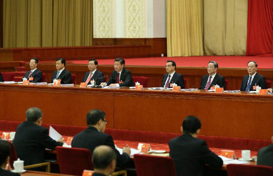 Chinese President Xi Jinping (rear C), who is also general secretary of the Communist Party of China (CPC) Central Committee, speaks at the Fifth Plenary Session of the 18th Communist Party of China (CPC) Central Committee, in Beijing, capital of China. The meeting was held from Oct. 26 to 29 in Beijing. (Xinhua/Ma Zhancheng)
