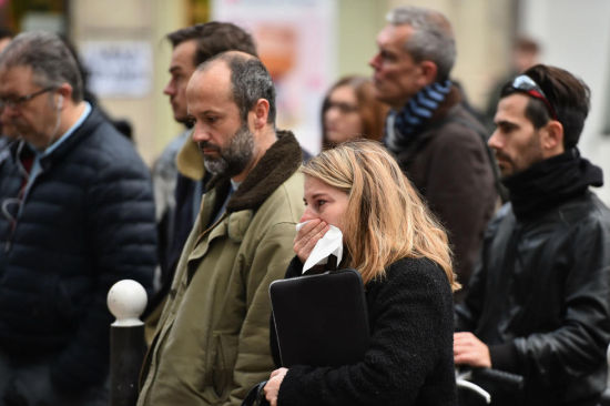 France led a minute's silence observed around the world on Monday in memory of the victims of the worst-ever terror attacks on French soil