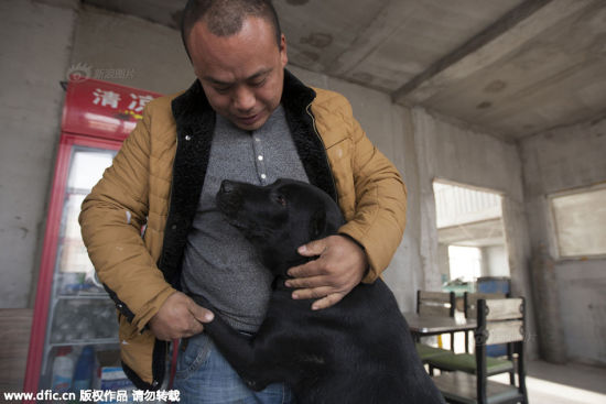 Wang Yan and a dog inside the rescue base.