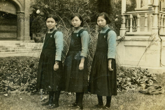 """Three girls posed for a group photo on a lawn in the early Republic of China period. Their coats were briefly colored. The """"New Clothes of Civilization"""" was also school uniform for female students."""