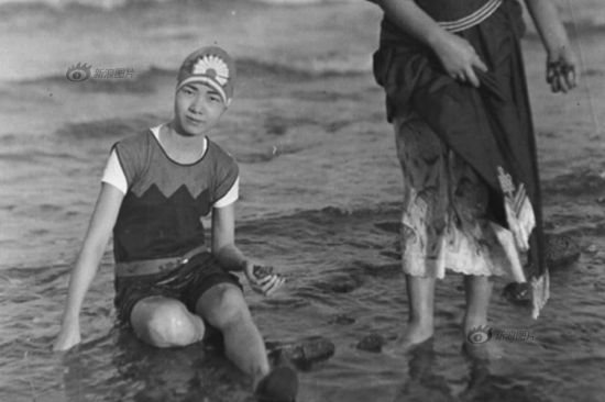 A woman was in a swimming suit in 1920. Swimming suits at this time followed closely to western styles, with a mini-skirt and a bathing cap.