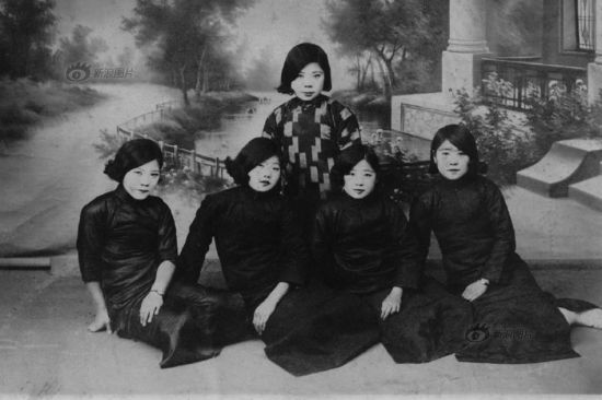 After the May 4th Movement, the society had been further liberated in terms of thinking. Women's clothes transformed from concealing the body to revealing the curvaceous features. A new style that had later become the staple of Chinese fashion emerged – Qipao first appeared in the brothels of Shanghai in the early 1920s, and was later favored by women of all social classes in China. This photo shows female students were dressed in Qipao.