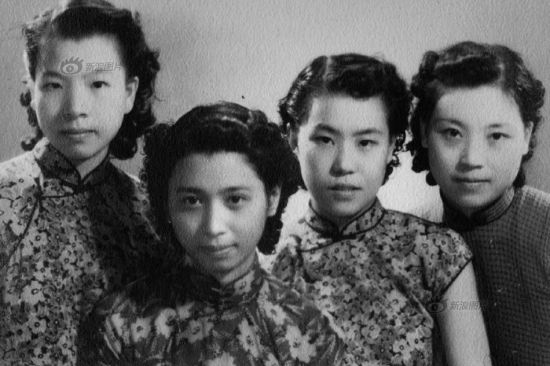 """Another major change of Qipao was the removal of sleeves. As Eileen Chung wrote, """"All the decorations, useful or not, are removed. There is only a tight vest, baring the neck, arms and shins out. Now the woman inside the gown is more important, while the Qipao only outlines her figure."""" The photo shows female students wearing Qipao with permed hair in the 1930s in Shanghai."""