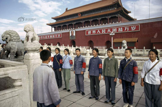"""The Red Guards were standing at the Tian'anmen Square in Beijing in 1973. Female Red Guards were dressed in grey, blue, green and white, wearing red armbands with bold signs of """"Red Guards"""". Photo/Bruno Barbey"""