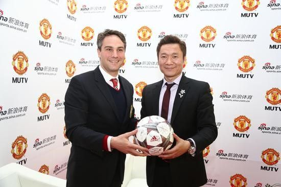 (Manchester United Commercial Director Jamie Reigle with Sina VP and GM of Sina Sports, Arthur Wei)