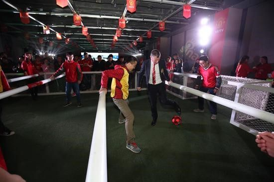 """(Denis Irwin plays """"life-size foosball"""" with lucky Chinese fans)"""