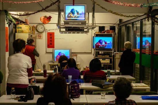 """Residents gather to sing Karaoke in the entertainment room of the village around 3 pm almost every day. """"I know that people on the mainland love square dances. Here we prefer singing,"""" says a middle-aged woman."""