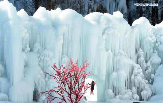 People visit the frozen waterfall at the Blood Fairy Spring of Shijiazhuang, capital of north China's Hebei Province, Feb. 13, 2016.