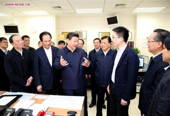 BEIJING, Feb. 19, 2016 (Xinhua) -- Chinese President Xi Jinping (C) talks with a correspondent who is just back from reporting in Zhengding County of Hebei Province, at the headquarters of Xinhua News Agency in Beijing, capital of China, on Feb. 19, 2016. Xi on Friday visited the People's Daily, Xinhua News Agency and China Central Television, the nation's three leading news providers. (Xinhua/Huang Jingwen)
