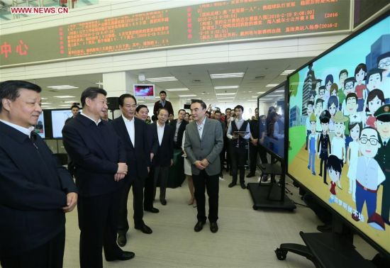BEIJING, Feb. 19, 2016 (Xinhua) -- Chinese PresidentXi Jinping(2nd L, front) watches a video at the headquarters of Xinhua News Agency in Beijing, capital of China, on Feb. 19, 2016. Xi on Friday visited the People's Daily, Xinhua News Agency and China Central Television, the nation's three leading news providers. (Xinhua/Lan Hongguang)