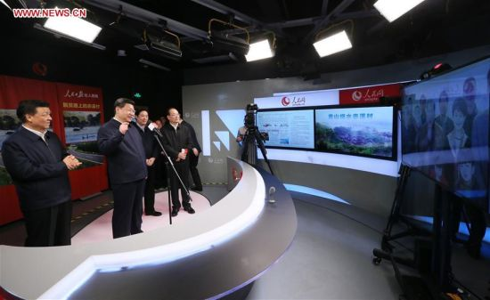 BEIJING, Feb. 19, 2016 (Xinhua) -- Chinese President Xi Jinping (2nd L) talks with villagers of Chixi Village in Ningde of southeast China's Fujian Province via videolink while visiting the People's Daily in Beijing, capital of China, on Feb. 19, 2016. Xi on Friday visited the People's Daily, Xinhua News Agency and China Central Television, the nation's three leading news providers. (Xinhua/Lan Hongguang)