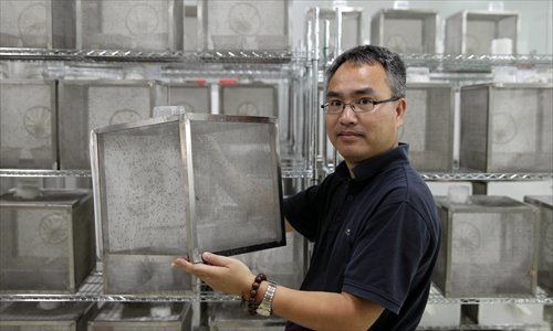 Professor Xi Zhiyong displays his mosquito-breeding facilities in Guangzhou. Photos: CFP