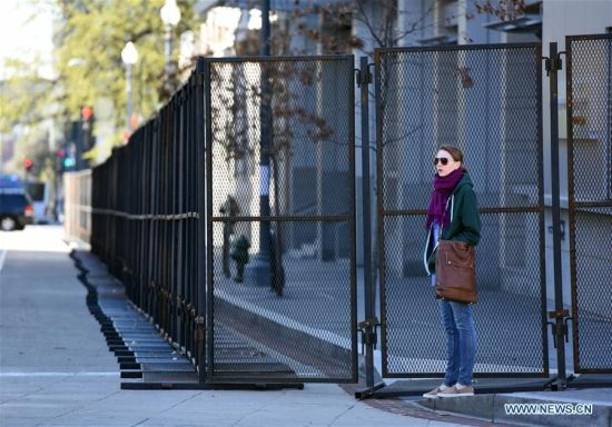 Pedestrian walks past barriers near the Walter E. Washington Convention Center in Washington, D.C., March 30, 2016. The fourth Nuclear Security Summit will be held here March 31-April 1, 2016. (Photo: Xinhua/Yin Bogu)