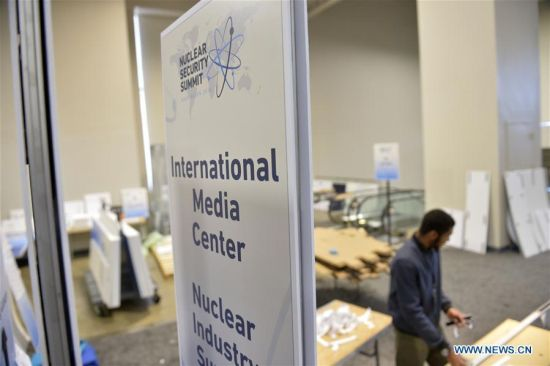 Workers prepare for the Nuclear Security Summit at the Walter E. Washington Convention Center in Washington, D.C., March 30, 2016. The fourth Nuclear Security Summit will be held here March 31-April 1, 2016. (Photo: Xinhua/Yin Bogu)