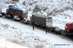 Snow hits NW China's Hami, causing traffic jam