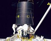 First three-person spacewalk