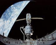 Shuttle's first international space station trek