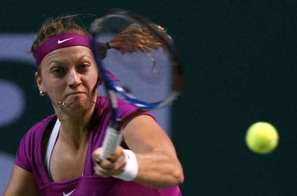 Wozniacki ousted by Kvitova, Azarenka into semis