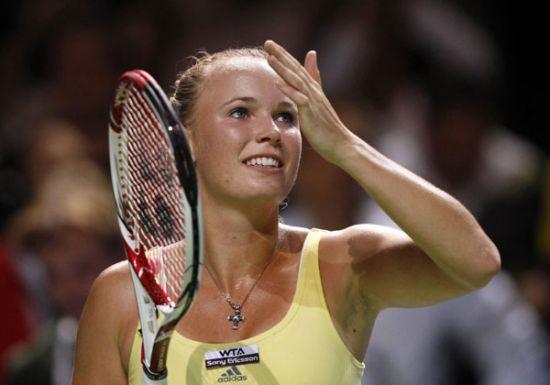 Wozniacki, Kvitova start with wins at WTA finals