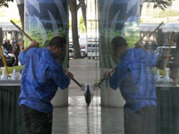 A window washer works on the Hawaii Convention Center