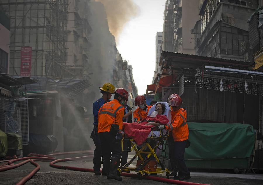 Rescuers help an injured person in Hong Kong