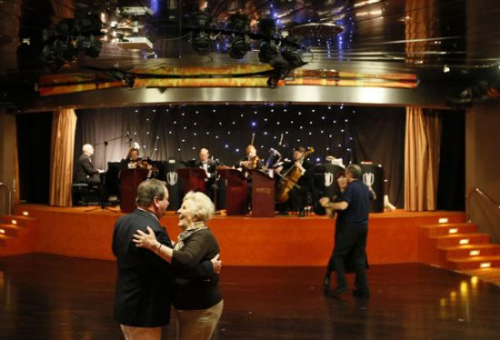 Passengers on the Titanic Memorial Cruise dance
