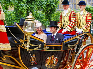 The Duke and Duchess of Cambridge take a carriage ride to Buckingham Palace.