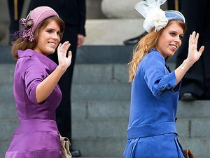 Princesses Eugenie and Beatrice wave to the crowds as they arrive at St. Paul's Cathedral.