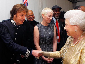 Sir Paul and Annie Lennox meet the woman of the hour backstage at the concert.