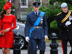 The Duke and Duchess of Cambridge, along with Prince Harry, make a dashing trio.