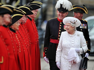 Queen Elizabeth greets pensioners on Chelsea Pier before setting sail.
