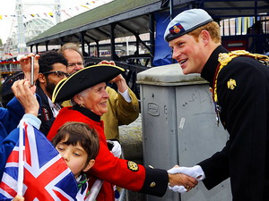 Harry stops to greet well-wishers before boarding the royal barge.