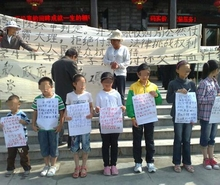 Children in unpaid wages fight