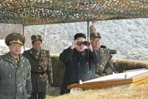 Kim Jong Un inspects troops,